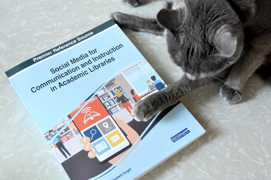 Social Media for Communication and Instruction book and cat